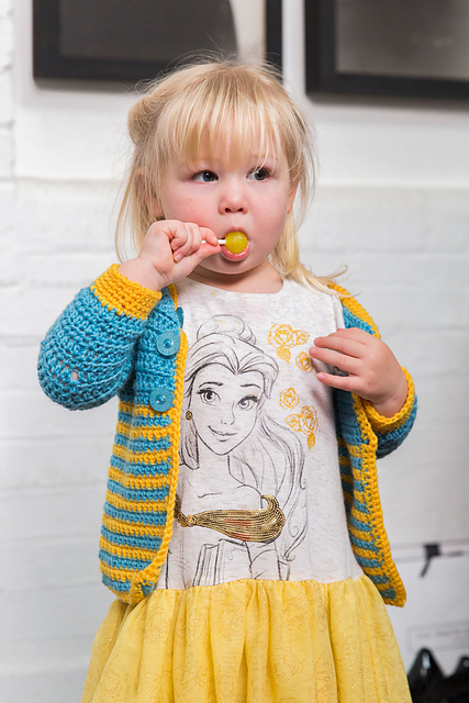 Child's crochet cardigan in blue and yellow stripes